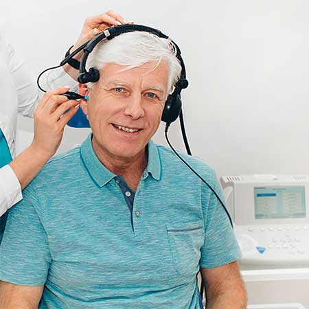Man getting an auditory test in a hearing clinic